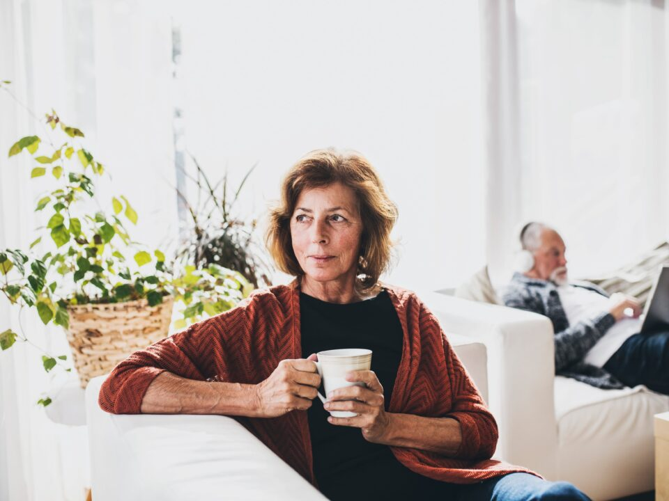 woman relaxed sitting on the couch